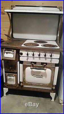 Antique wood and electric cook stove Monarch brand