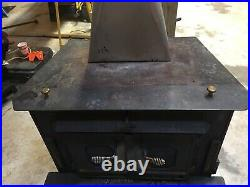 Buck 28000 Woodburning Stove With Blower And Door Screen. Inlaid Glass Doors